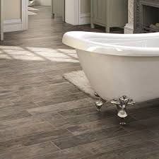 introduce a natural element to your bath with resilient water resistant wood or stone look porcelain tile tiled floors