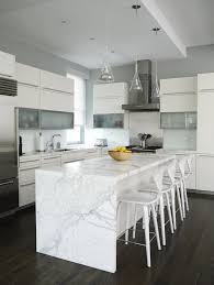 calacatta marble kitchen waterfall: white marble top kitchen contemporary with stainless steel appliances calacatta marble
