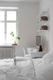 all white bedroom with desk