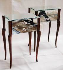 nifty full mirrored bedside table with four thin leg made from wood