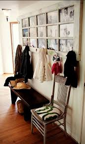 old door made into a coat rack with photo display love this
