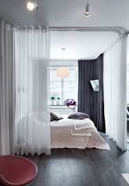 Create a devided bedroom with curtain rails