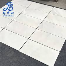 china 600x600mm high gloss floor tiles polished glazed anti slip geneous tiles