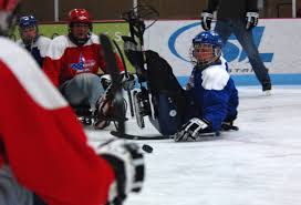 hockey essay u s department of defense photo essay behind the mic  u s department of defense photo essay a veteran participating in a game of sled hockey falls