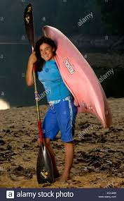 Teen poses with paddle