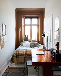 nice bedroom arrangement. very small bedroom with floating bed and wooden desk table paired chair : nice arrangement i