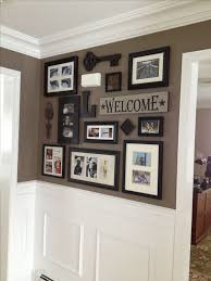 Picture collage for front entry and impressive wainscoting/crown moulding.  Good paint scheme. Picture WallsPainting Picture FramesDining ...