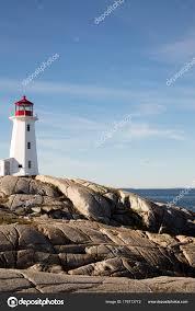rocky sline at peggys cove lighthouse nova scotia canada stock photo