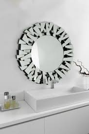 there are 64 individual bevelled pieces of glass which go into making this diverse angled designed frame each mirror is hand assembled and will surely be a