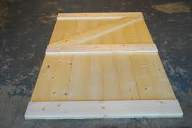 repeat this step cutting the diagonal board in the opposite direction for your second barn door this will leave you with one door having a z shape and