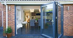 a 3 part bi folding door fitted to a kitchen extension giving diners an outdoor experience