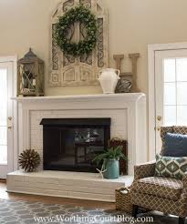 Fireplace AFTER. Red brick fireplace with brown trim painted white and  brass fireplace screen painted
