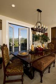 innovative hurricane candle holders in dining room terranean with rustic chandelier next to dining room light fixture