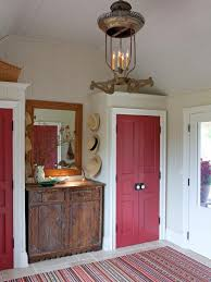 cottage mudroom with cranberry red closets