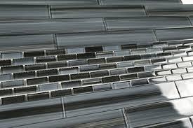 black glass tile backsplash