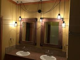 bathroom lighting chandelier. Swag Chandelier With Black Round Cages Hanging Around A Mirror Bathroom Lighting G