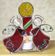angels holiday stained glass tea light holder is a beautiful accent piece to any holiday decor constructed in genuine stained glass the holder includes a