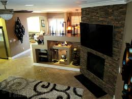 tie together your fireplace design by adding a faux stone wall to complement the look of the existing fireplace