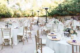 los angeles outdoor wedding at eden gardens reception set up with white table linen and gold