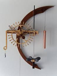torsion pendulum clock. radiance is a one-wheel, no gear clock that impulses its free torsion pendulum once every two minutes.