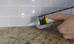 How To Remove Kitchen Tiles How To Install Caulk On A Kitchen Tile Backsplash Youtube