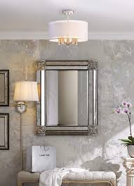 lighting low ceiling. french style room with bench and silver mirror lighting low ceiling
