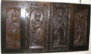 four carved oak panels circa 1720