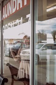 laundromat furniture. Girl Woman Window Home Furniture Room Door Laundry Laundromat Interior Design Display Covering