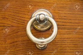 old br ring door handle on urban door stock photo 16862825