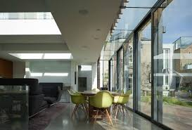 a glass building extension with a multi panel glass roof