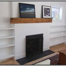 to fireplaces with bookshelves on each side shelves by floating shelves get some of those cabinets off the