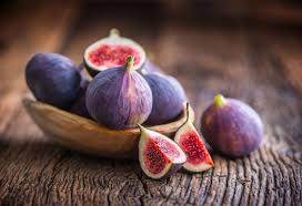 figs kept on a wooden table