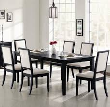 furniture rectangle black wooden dining table and six black wooden dining chairs with white fabric