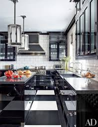 black and white the kitchen of a manhattan duplex decorated by steven gambrel features pendant lights from the designers