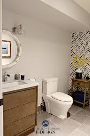 ideas to add style to small bathroom herringbone marble tile feature wall wood vanity