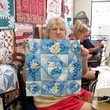 Attic Window Quilt Shop: NEW TEACHER AT ATTIC WINDOW QUILT SHOP & Marilyn also teaches the Storm at Sea classes using the Creative Grid  Ruler. Above Nancy shows us her block that she made in the class. Adamdwight.com