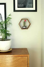 add some mid century charm to your gallery wall with this diy wall art idea on wall art shelf with popsicle stick hexagon shelf easy diy wall art