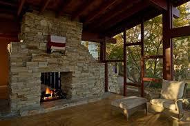 amazing indoor stone fireplace designs brown tile floor cream