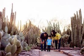 a family enjoys a sunny day at the desert botanical garden
