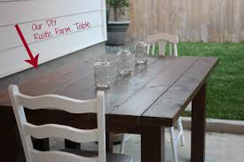 custom diy solid wood outdoor farmhouse dining table with mason jars centerpieces and white ladder chairs for outdoor dining area in backyard patio ideas