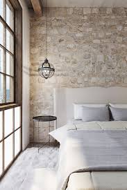 Exposing raw and rough brick walls is one of the popular renovation ideas  and designing with bricks. The exposed brick stone wall transformed a hotel  ...
