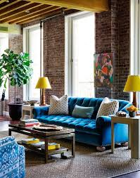 brick living room furniture. yellow and blue living room features exposed brick walls beamed ceiling over turquoise velvet furniture l