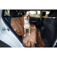 dog sitting up on the ruffwear dirtbag seat cover a durable waterproof cover that