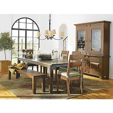 basque honey 104 dining table in dining tables crate and barrel handcraftedsustainable kiln dried solid mango woodfinish naturally occurring grain