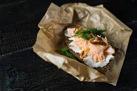 Sandwich With Smoked Salmon Fillet On Black Bread With Soft Cheese