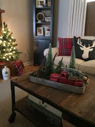 Integrate your coffee table and the items in your display with the rest of your space. Coffee Table Christmas Decorating Red Truck Christmas Coffee Table Decor Christmas Table Decorations Christmas Decorations Rustic