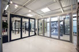 dual sets of aluminium bifolding doors in light grey and ral 7016 antracite grey