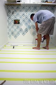 How to paint vinyl/laminate floors! It's easy and inexpensive! Click  through for