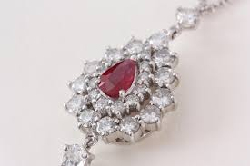 lot 157 an 18ct white gold ruby and diamond pendant of pear shape for app 3 carat of diamonds