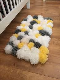 Gorgeous fluffy pom pom rug, perfect for a nursery to keep feet warm and  cosy